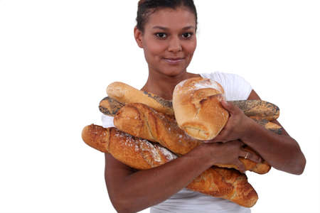 young black woman holding a lot of bread in her arms photo
