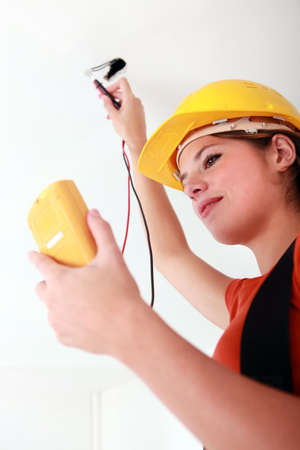 measuring instruments: female electrician working
