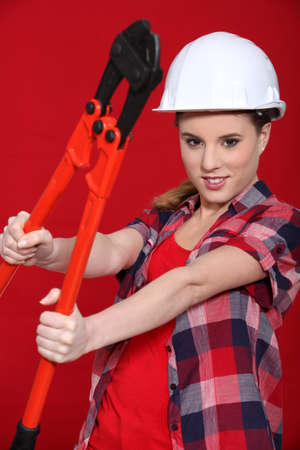 Woman holding bolt cutters Stock Photo - 11338870