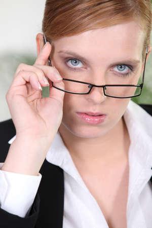 superior: Serious businesswoman
