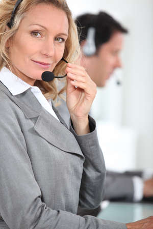word processor: Blond call centre worker Stock Photo