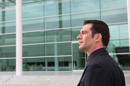 Businessman outside a glass fronted building Stock Photo - 11338817