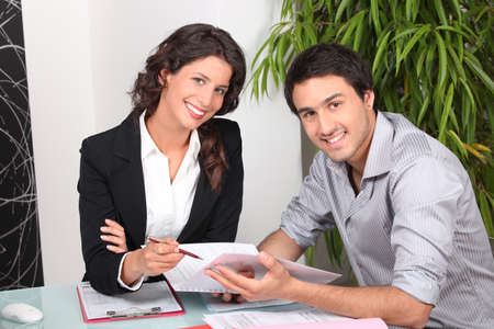 Businesswoman discussing a contract with her client photo