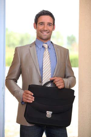 doorways: Businessman coming through a domestic doorway