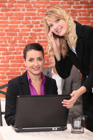 Women reading emails on laptop Stock Photo - 11338859