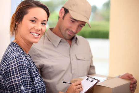 Woman signing for a package photo