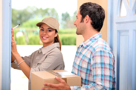 obtain: man receiving package from a delivery girl Stock Photo