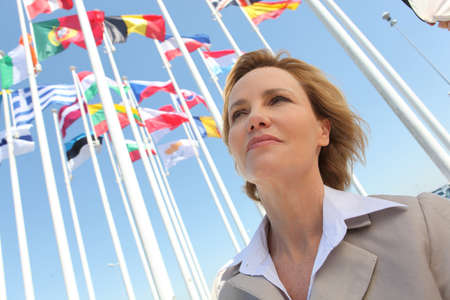 35 40 years: Businesswoman with flags. Stock Photo