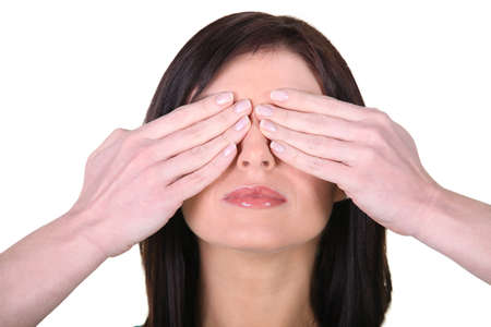 Woman with her hands over her eyes photo