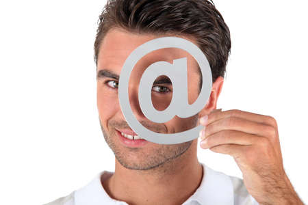 e mailing: Man covering eye with at symbol