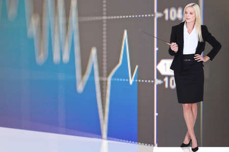 ceo: Woman stood by stock update Stock Photo