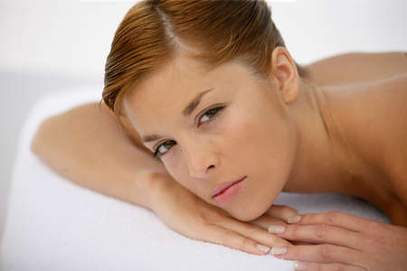 Woman waiting for massage photo