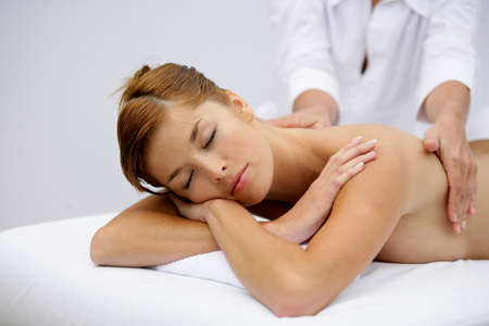 Gorgeous woman having a back massage Stock Photo - 11338820