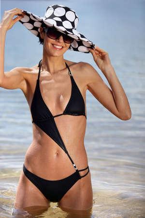 bikini bottom: Woman in stylish swimwear and a floppy hat Stock Photo