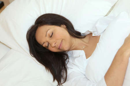 Woman asleep in her bed photo