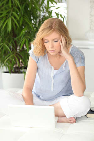 outwork: Woman with laptop sat on couch