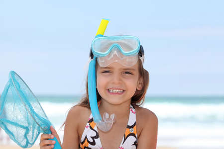 Little girl with snorkel and flippers photo