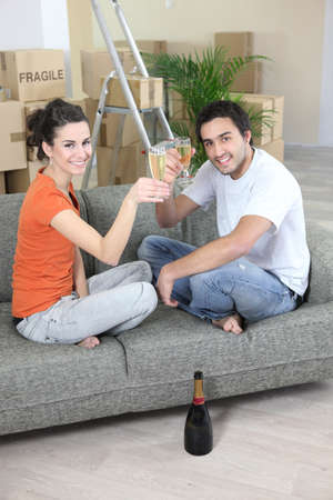 Couple drinking champagne after house move photo