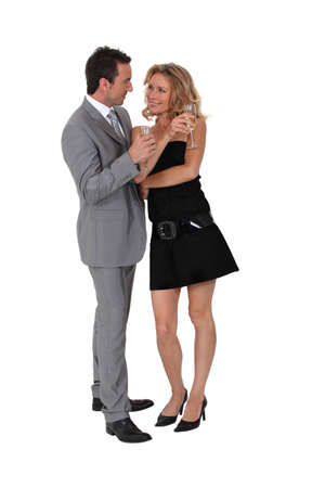 affairs: Couple drinking champagne and flirting Stock Photo