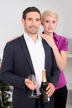 Couple having a glass of wine together Stock Photo - 11342226