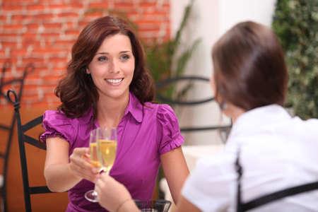 Women drinking champagne in a restaurant photo