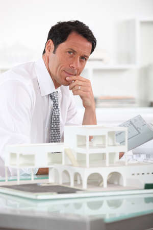 45 49 years: Architect with plans and 3D model Stock Photo