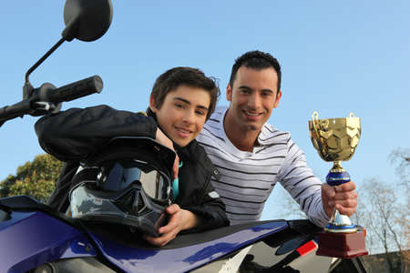 boy winning a motorcycle racing cup photo