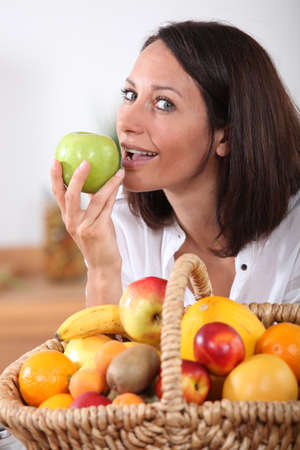 portrait of a woman with fruit basket photo
