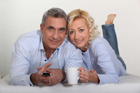Middle-aged couple watching television Stock Photo - 11306652
