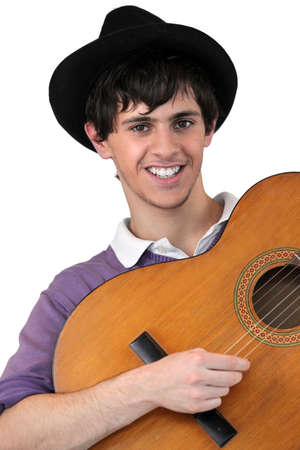 Young man playing guitar Stock Photo - 11303098