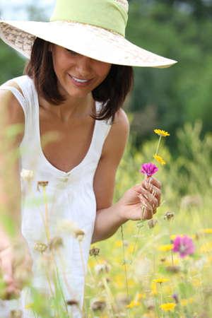 Woman picking wild flowers photo