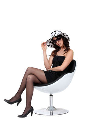 high heels: Brunette wearing sunglasses and hat