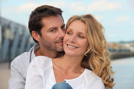 Man kissing his partner by the water Stock Photo - 11306671