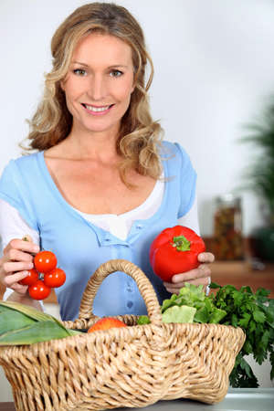 woman 40 years: Wife holding pepper and tomatoes Stock Photo