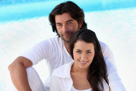 Loving young couple sitting by a pool Stock Photo - 11294286