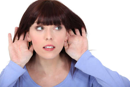 straining: Woman making listening gesture