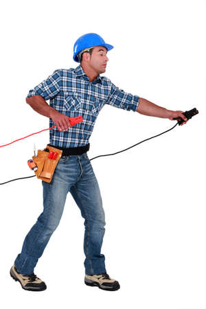 clamps: A handyman with power clamps.
