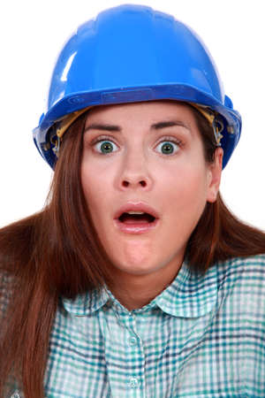 nauseous: Shocked woman in a hard hat
