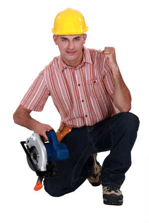 A carpenter making a yes gesture. photo