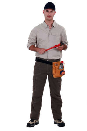 blue collar: A handyman with a wrench. Stock Photo