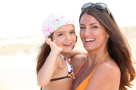 Mother and daughter at the beach photo