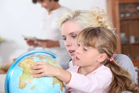 emigration: housewife with child and globe
