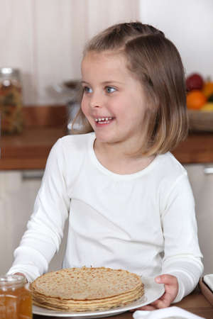 Little girl holding a plate of crepes Stock Photo - 11306667