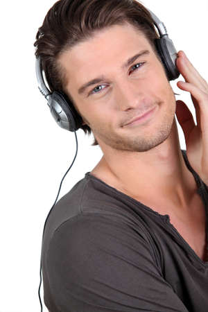 enjoy space: Man listening to music on his headphones