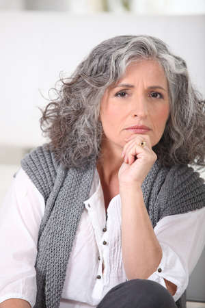 concerned: Portrait of an older woman Stock Photo