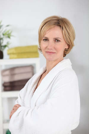 toweling: Woman wearing a white toweling bathrobe