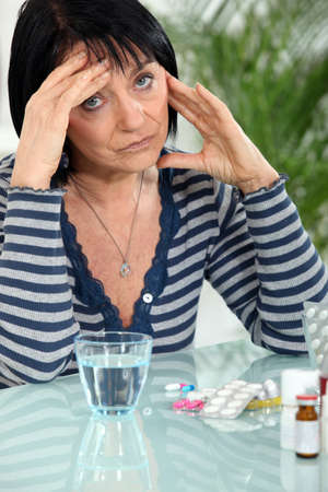 mature woman having a headache photo