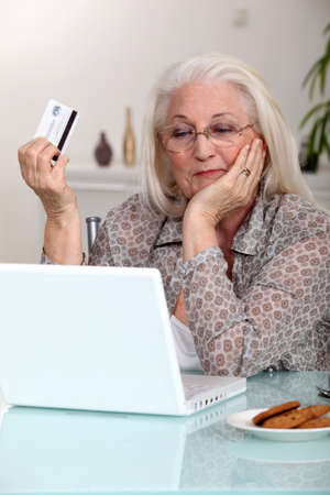 Elderly woman shopping on-line photo