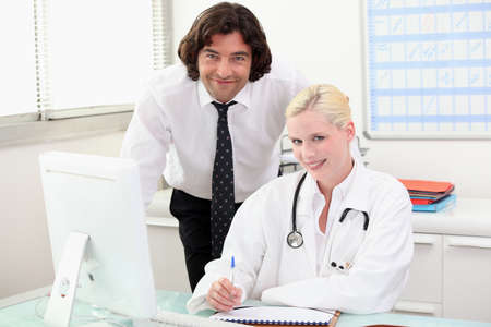 Doctor at a desk Stock Photo - 11293863