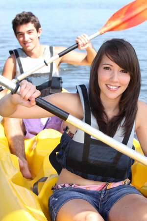 kayak: Couple kayaking on a warm summer